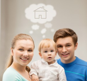 home, real estate and family concept - family with child dreaming
