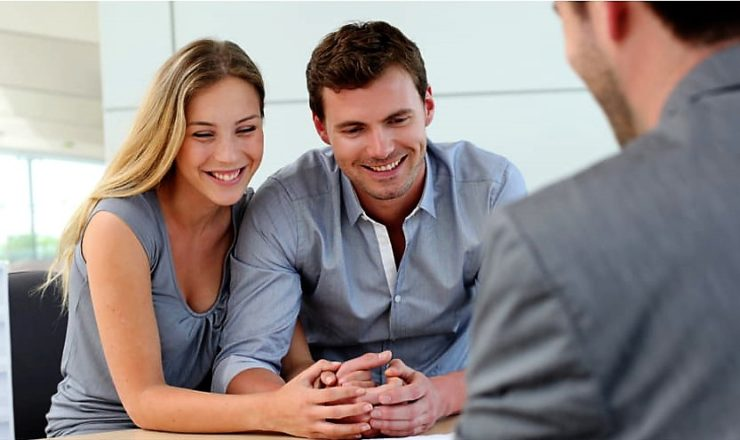 Young couple meeting financial advisor